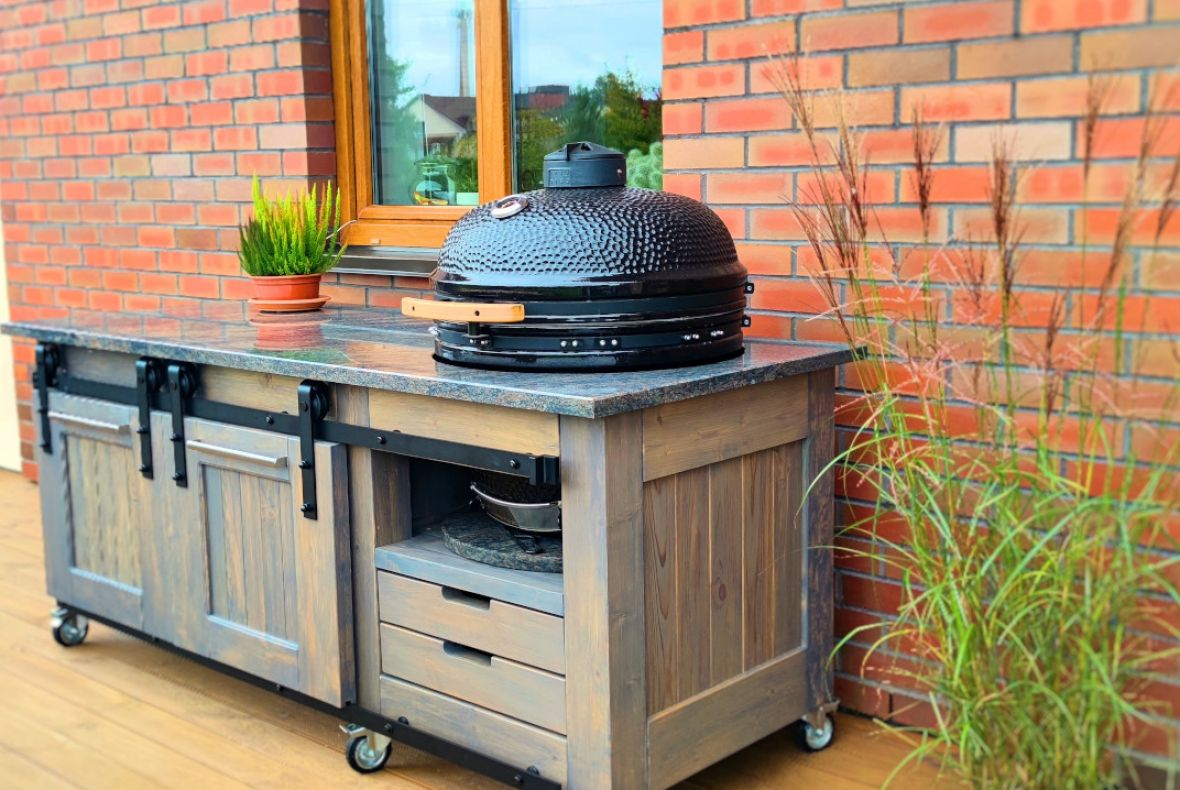 """Granite stone table top with an opening for """"Kamado"""" barbecue"""